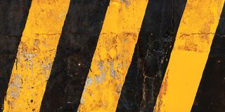 Modello nero giallo a strisce di cautela fotografie stock libere da diritti