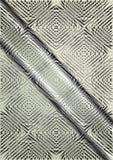 Modello in rilievo leggero su un fondo dell'acciaio del raso Fotografia Stock Libera da Diritti