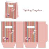 Modello rosa della borsa del regalo con le bande variopinte ed i cuori illustrazione di stock