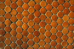 Modello rotondo arancio delle mattonelle Immagine Stock