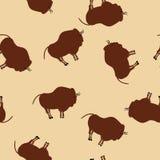 Modello senza cuciture BG beige dei disegni primitivi del bisonte illustrazione vettoriale