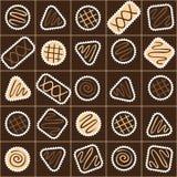 Modello senza cuciture con differenti caramelle di cioccolato in una scatola Fotografia Stock Libera da Diritti
