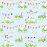 Modello senza cuciture con i conigli di Pasqua dell'acquerello in erba, uova e ghirlande con le bandiere Fotografia Stock Libera da Diritti