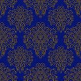 Modello senza cuciture con l'ornamento disegnato a mano su un fondo blu Fotografie Stock Libere da Diritti