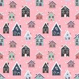 Modello senza cuciture con le belle case di nevicata sul perno immagine stock