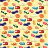 Modello senza cuciture con le pillole su fondo leggero Fotografia Stock
