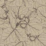 Modello senza cuciture decorativo con le nocciole e le foglie Fotografia Stock