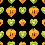 Modello senza cuciture del kiwi, cachi nel cuore sul bl Fotografie Stock