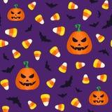 Modello senza cuciture di Halloween con i semi e le zucche della caramella Illustrazione di vettore Fotografia Stock