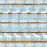 Modello senza cuciture di Natale con i cervi ed i fiocchi di neve Fotografia Stock