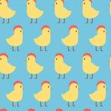 Modello senza cuciture di Pasqua con il pollo giallo sveglio su fondo blu royalty illustrazione gratis