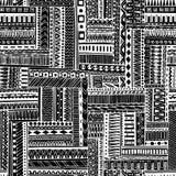 Modello senza cuciture tribale geometrico strutturato a strisce astratto Fondo in bianco e nero di vettore La struttura senza fin Immagini Stock