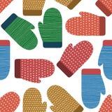 Modello senza cuciture tricottato dei guanti Inverno, natale, fondo variopinto del nuovo anno, insegna, carta da parati, avvolgen Fotografia Stock