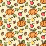 Modello sveglio con la zucca arancio, mela gialla, mela rossa, foglia verde, dado, quercia, ghianda Fotografia Stock