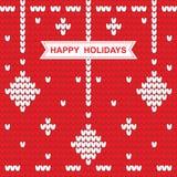 Modello tricottato di Natale con le feste felici di parole su rosso Immagine Stock