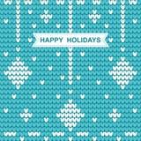 Modello tricottato di Natale con le feste felici di parole sul blu Immagine Stock