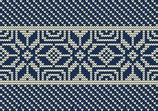 Modello tricottato su un fondo blu Bordo senza giunte Fotografia Stock