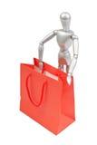 Modello umano del manichino d'argento con i sacchetti della spesa Fotografia Stock