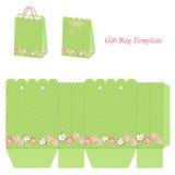 Modello verde della borsa del regalo con le bande ed i fiori illustrazione vettoriale