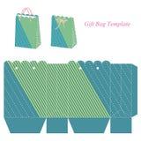 Modello verde della borsa del regalo con le bande ed i punti illustrazione di stock