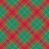 Modelo abstracto con la tela clásica de la tela escocesa en un fondo verde Imágenes de archivo libres de regalías