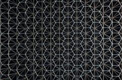 Modelo abstracto del metal bajo la forma de construcción inoxidable Imagenes de archivo