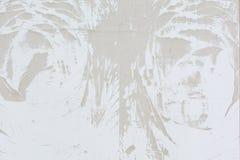 Modelo abstracto del polvo, en una pared gris pálida Fondo en blanco Imágenes de archivo libres de regalías
