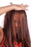 Modelo asiático con el pelo en cara Fotos de archivo