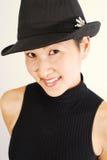 Modelo asiático em Fedora Foto de Stock Royalty Free