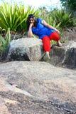 Modelo asiático en terreno rocoso Fotos de archivo