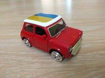 Modelo azul amarelo vermelho do carro de metal do brinquedo Foto de Stock