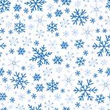 Modelo azul inconsútil con los copos de nieve libre illustration