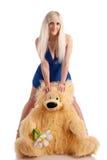 Modelo bonito com um urso nas mãos Fotos de Stock