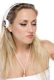 Modelo bonito con el auricular blanco Fotos de archivo