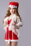 Modelo bonito da mulher de Ásia na roupa de Santa Claus Foto de Stock