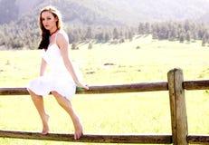 Modelo bonito em uma cerca foto de stock royalty free