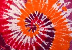 Modelo colorido del diseño del espiral del remolino del teñido anudado Fotos de archivo libres de regalías