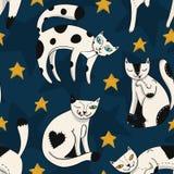Modelo colorido inconsútil con los gatos divertidos con las estrellas en fondo azul marino del cielo Foto de archivo