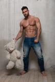 Modelo com urso de peluche Imagens de Stock
