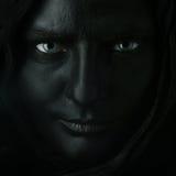 Modelo con la cara negra. imagen de archivo