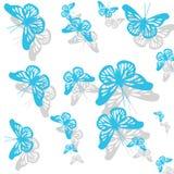 Modelo con las mariposas azules de la primavera Imagenes de archivo