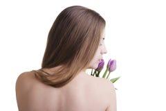 Modelo con los tulipanes Imagen de archivo