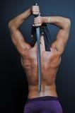 Modelo con una espada Fotografía de archivo