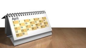 modelo 3D de um calendário do desktop de abril na cor branca em uma tabela de madeira no fundo branco Foto de Stock
