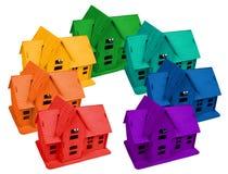 Modelo de casas en colores del arco iris, collage imagen de archivo