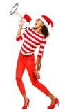 Modelo de fôrma 'sexy' no chapéu vestindo vermelho do Natal Fotos de Stock Royalty Free