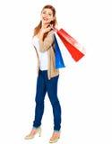 Modelo de forma com saco de compras Fundo branco isolado completo fotografia de stock
