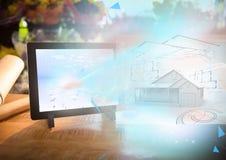 modelo de la casa 3D que sale de la tableta Imagen de archivo