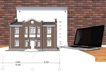 Modelo de la casa y del ordenador portátil en la tabla Imagen de archivo