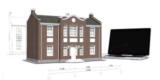 Modelo de la casa y del ordenador portátil en la tabla Imagenes de archivo